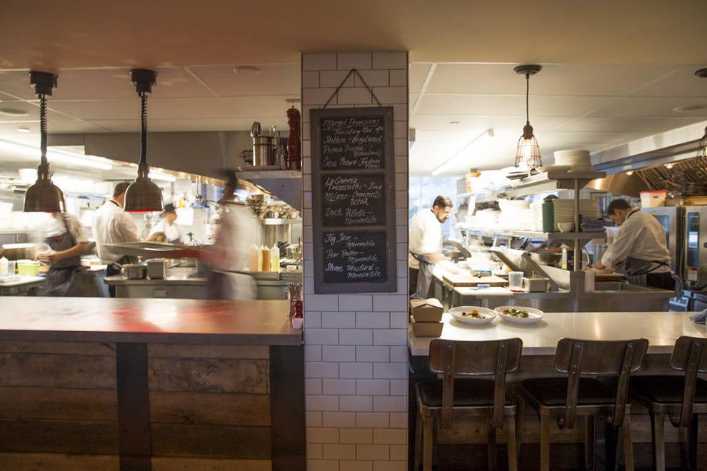 The open kitchen invites customers and cooks into a dialogue about food, sourcing and recipes