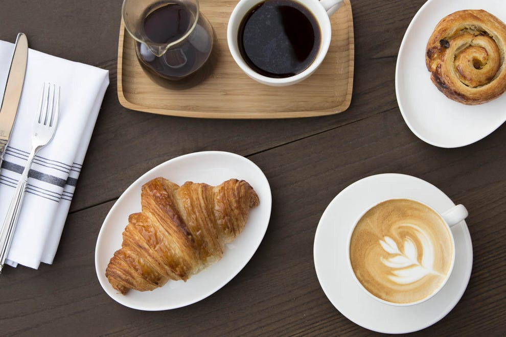A coffee bar supplies caffeine-lovers with espressos and other coffee drinks, and there are pastries that pair perfectly