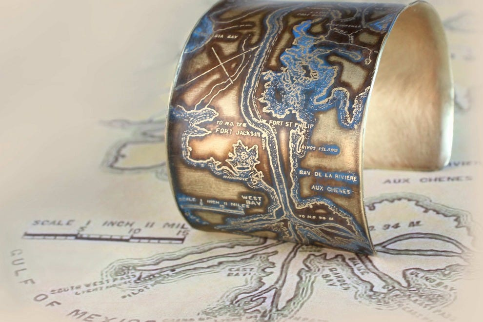 Wear a bend in the Mississippi on your arm with this cuff by artist Brandi Couvillion at the Ogden