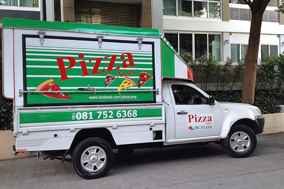 A Pizza Aroy food truck heading into town