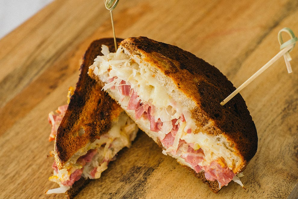 Indulge in classic favorites like this Reuben sandwich at The Candy Apple Cafe