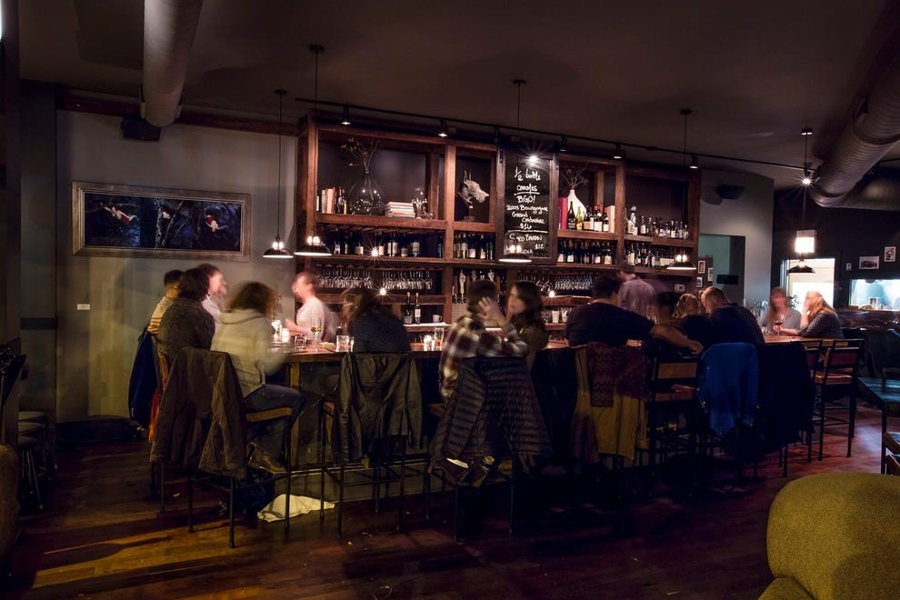 At Webster's Wine Bar, the long wooden bar makes it easy to enjoy company and a glass of wine