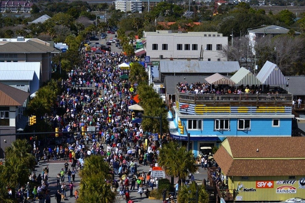 FollyGras revelers enjoy sunny weather, live music and tons of local food throughout the week