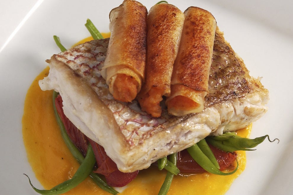 Denver may be far from the ocean, but fresh fish stars on many menus, including this bass entree offered at Kevin Taylor's at the Opera House