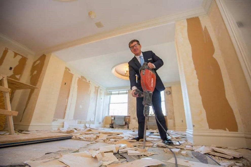 Mayflower's General Manager John Montano helps with the first room to be renovated