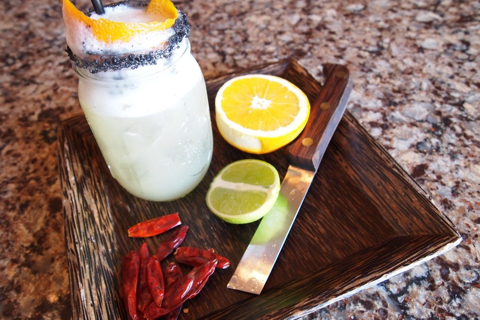 "Mezcal, says C&L bartender Mike Bass, is tequila's ""smokier sister"""