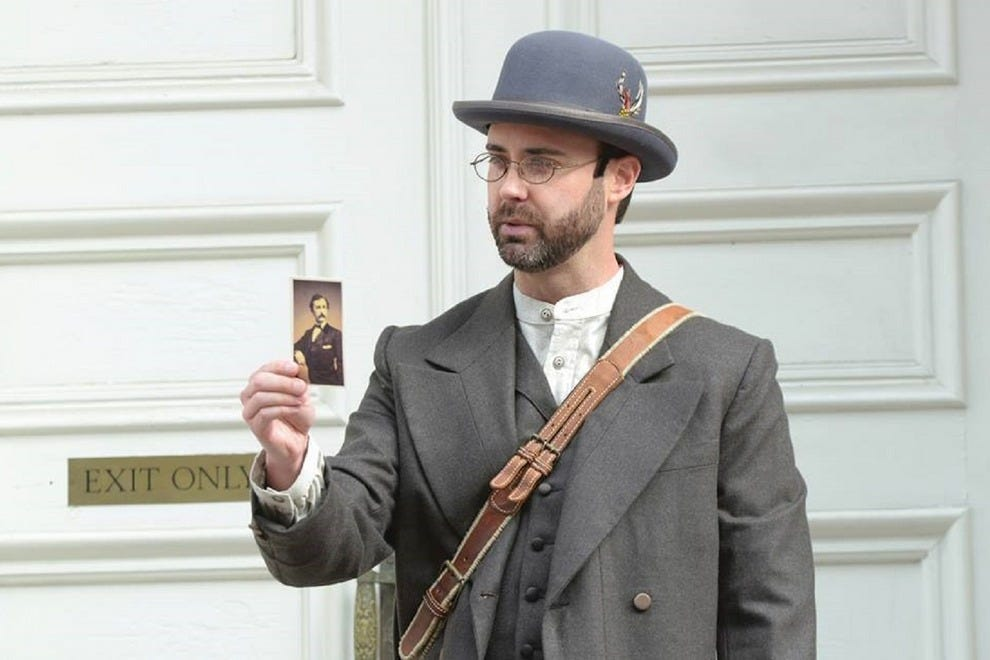 An actor potrays a detective on the hunt for John Wilkes Booth during a walking tour outside Ford's Theatre