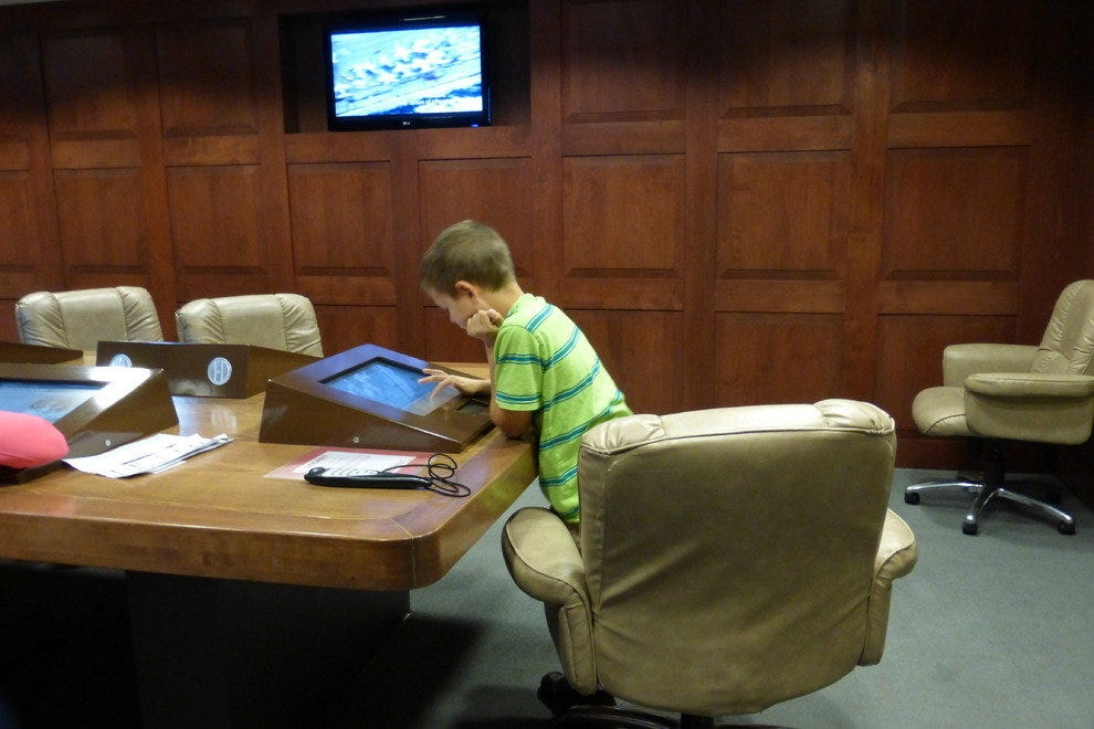 A young visitor concentrates on solving a problem in the Situation Room