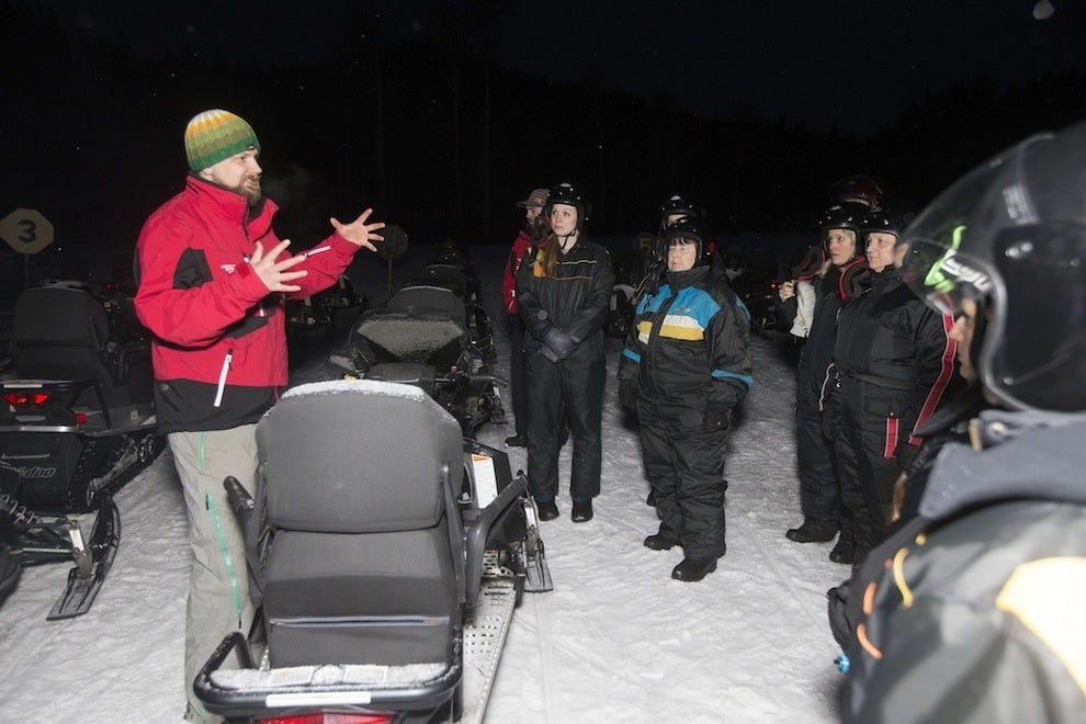 Adventurers at Mountain Springs Lodge get a quick tutorial before hopping on their snowmobiles
