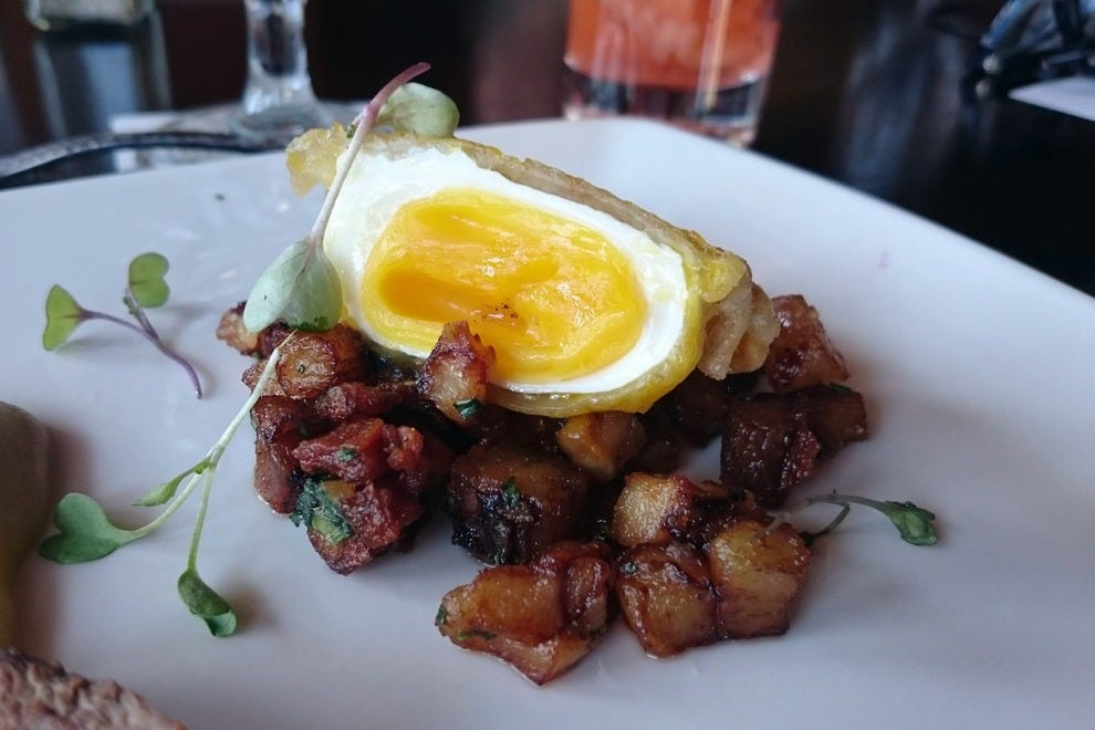Consult your cardiologist before savoring the Pork Hashtagged, a decadent new brunch item