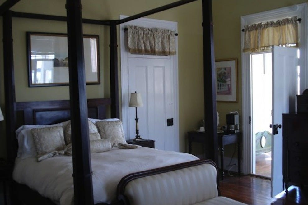 Each of The Palmer Home guestrooms offers antique furnishings and access to the mansion's second-floor piazza, pool, grounds and common areas
