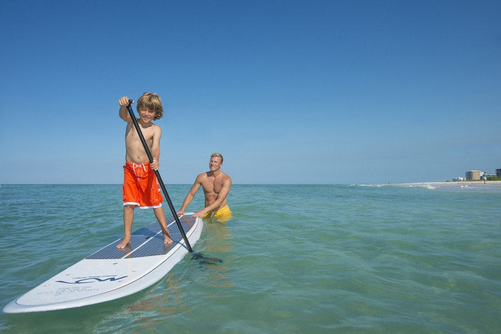 Go paddle boarding, kayaking or more with your family at the Longboat Key Club