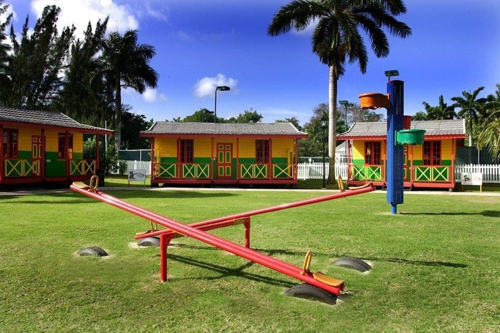 The colorful village is a kiddie heaven, surrounded by palm trees