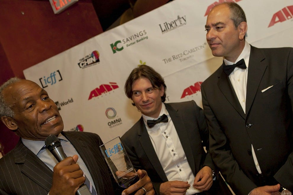Danny Glover (award receiver); Cristiano de Florentiis (co-founder and artistic director); and Maurizio Magnifico (co-founder and managing director) at the Italian Contemporary Film Festival