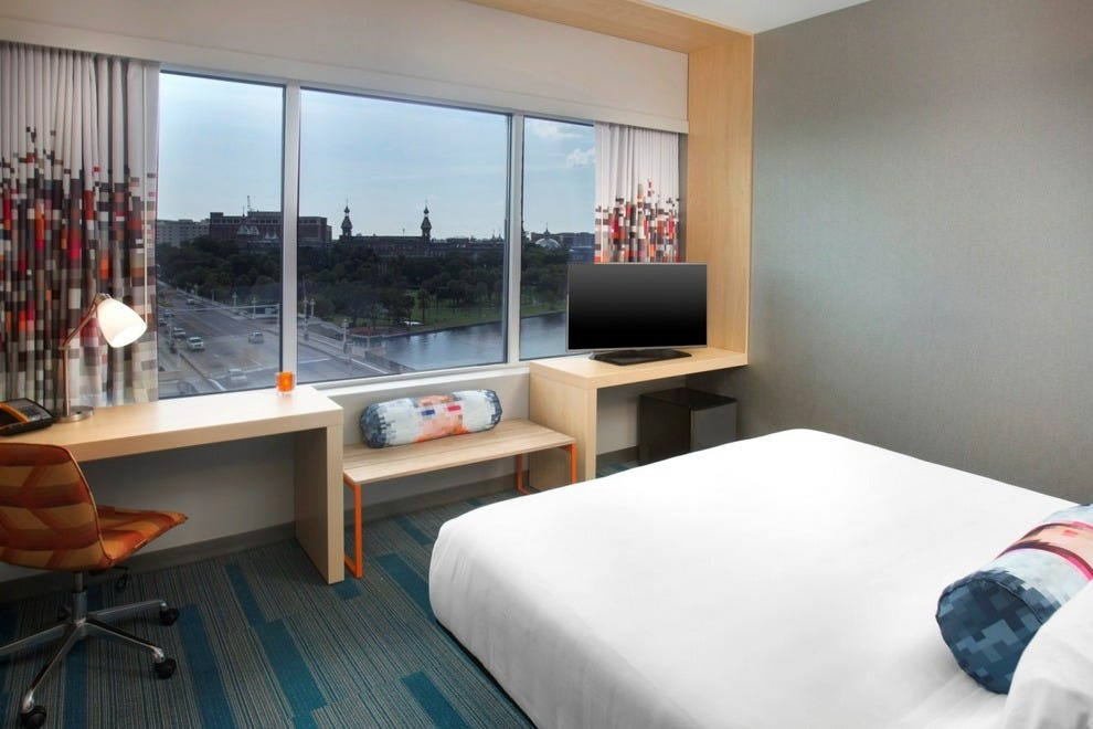 High ceilings and large windows complement the clean, modern décor of Aloft's guest rooms