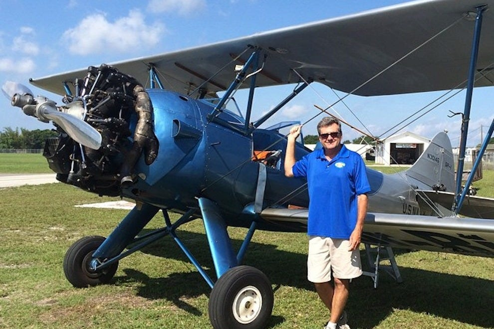 Mark Grainger stands by his WWII biplane