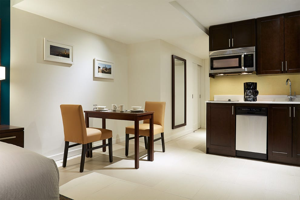 The dining area of a room at Residence Inn Montreal Downtown