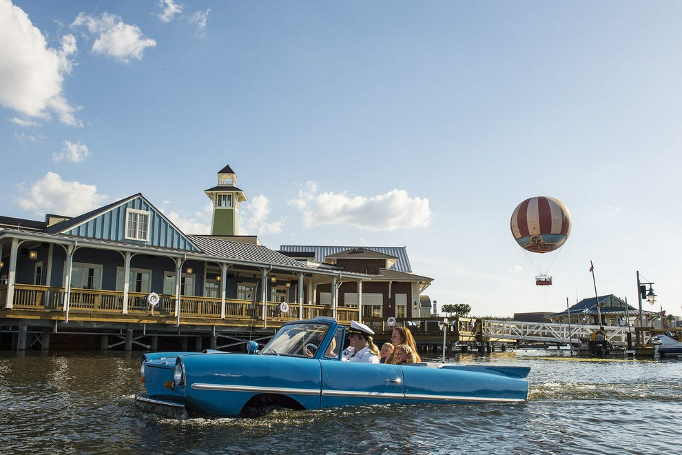 Guests embark from The Boathouse for a captain-guided Amphicar tour around Lake Buena Vista