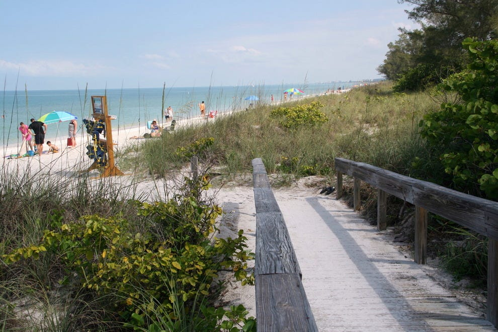Boardwalks cross dunes and native vegetation en route to beautiful sand and water at Delnor-Wiggins Pass State Park