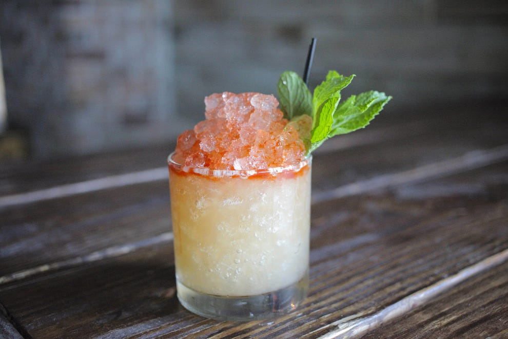 Housemade mixes and fresh ingredients come together in tropical concoctions at Flask & Cannon