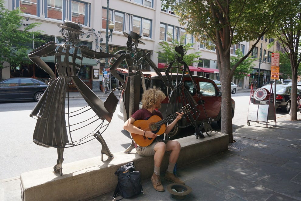 Art in Asheville is not limited to galleries: a plethora of street musicians add to the ambiance