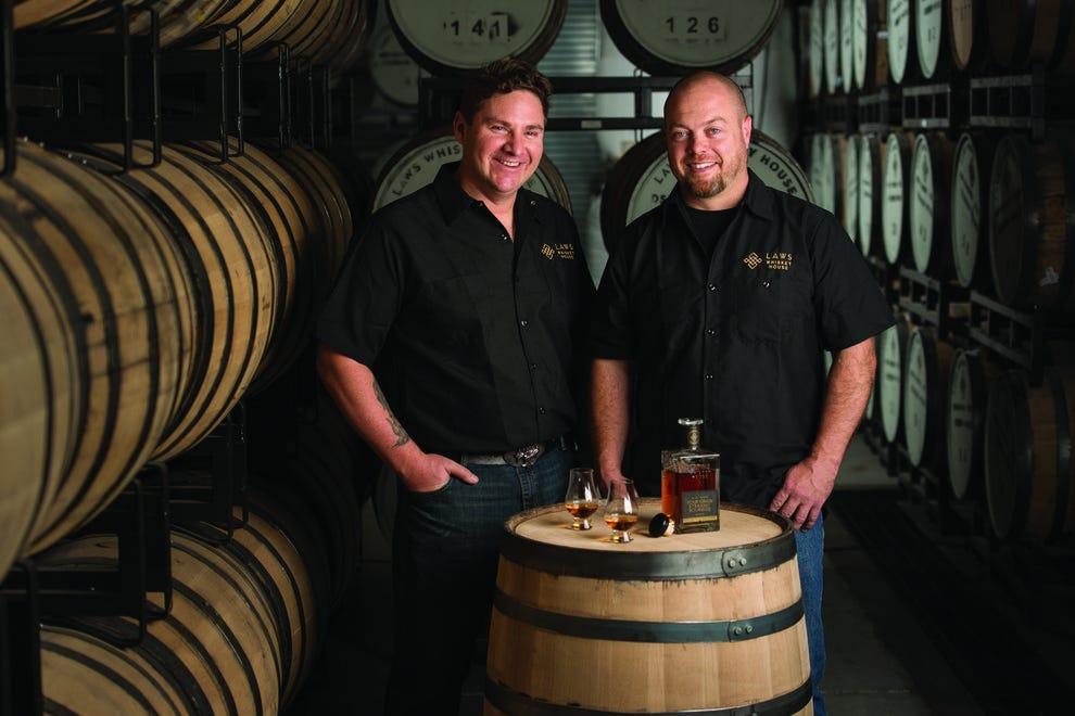 "Al Laws, left, and Jake Norris are committed to ""slow bourbon,"" whiskey made the old-fashioned way with no shortcuts"