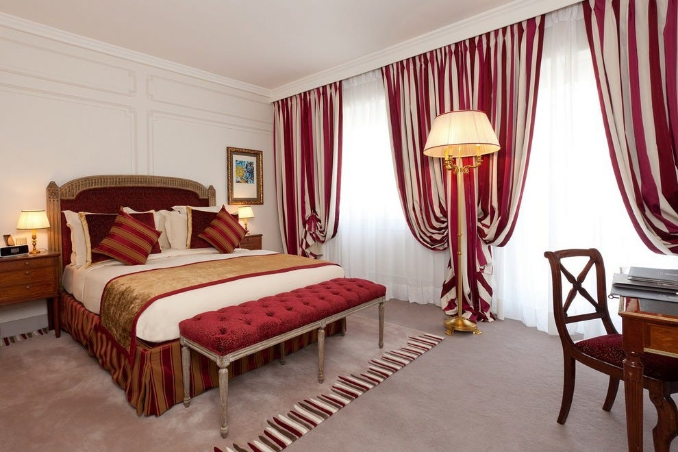 A deluxe room at Villa Hôtel Majestic