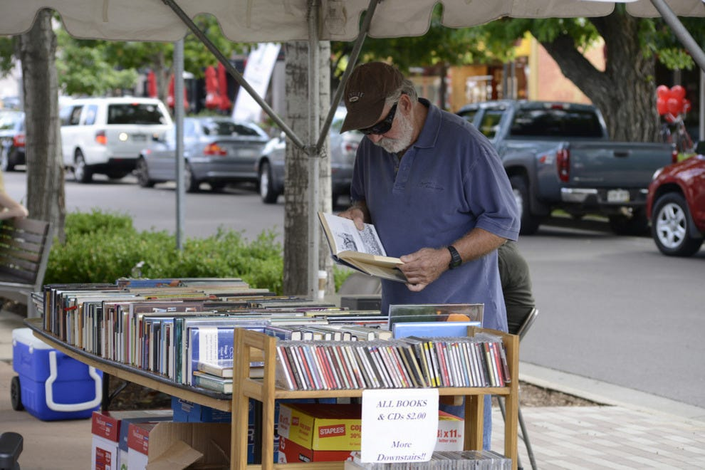 The sidewalk sale is not just for women; there's plenty to entice savvy male shoppers, including books