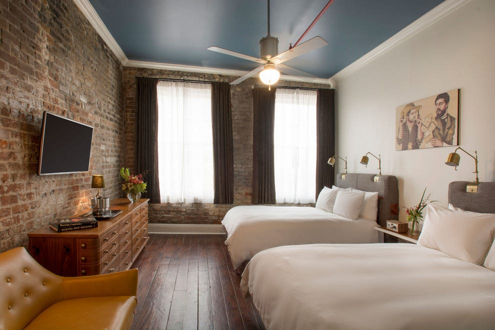 Each of The Old No. 77's guest rooms is hung with reproductions of original local art
