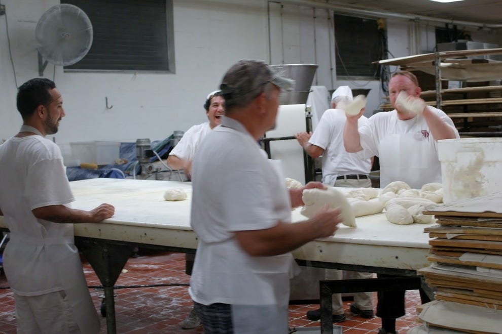 Bakers work in three shifts to produce 15,000 loaves a day at La Segunda