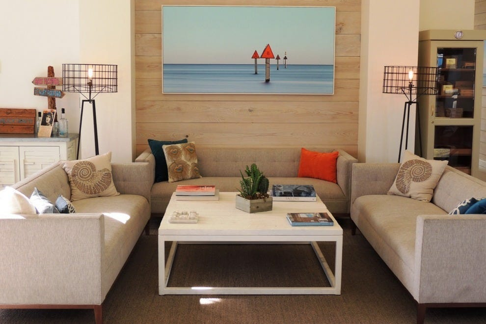 Contemporary decor at The Gates features seascapes by local photographer Jorge de la Torriente of De La Gallery
