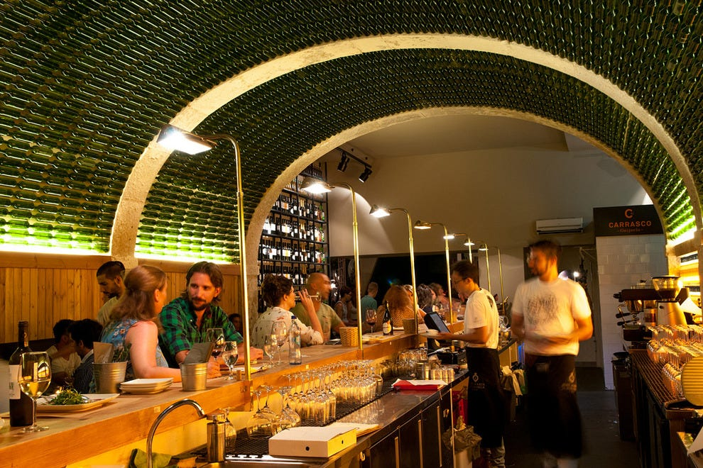 The bar's principal salon, set under a ceiling display of over 3000 bottles