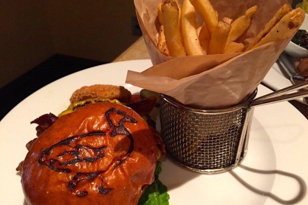 The Capriccio burger includes a branded bun featuring the famous Peabody duck