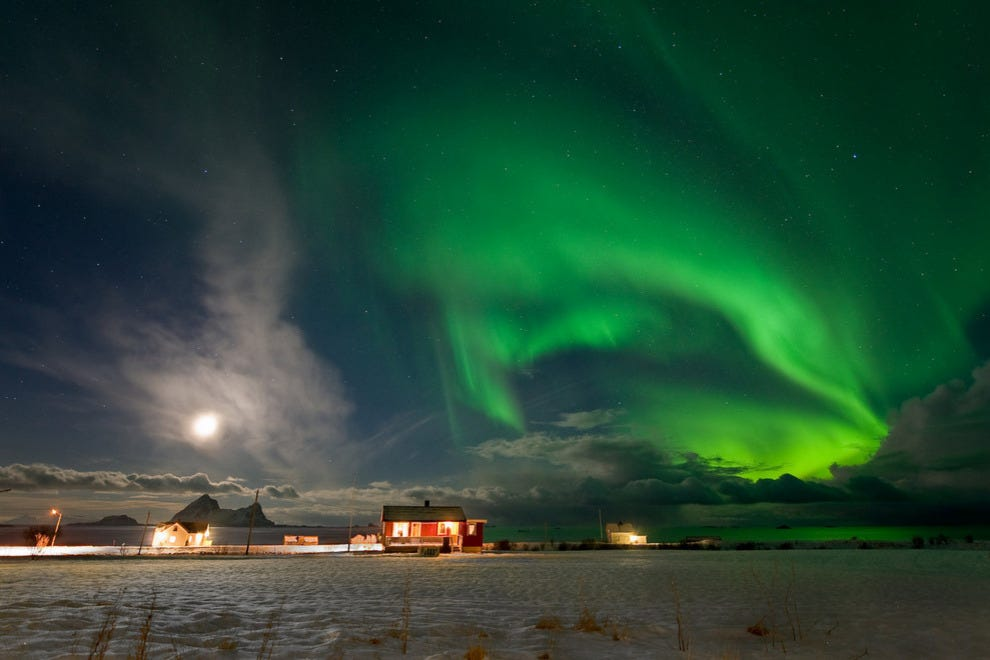 Northern Lights swirl over a home in northern Norway.
