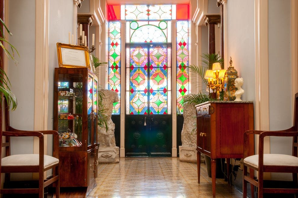 Intricately patterned stained glass windows help color the hotel's public spaces