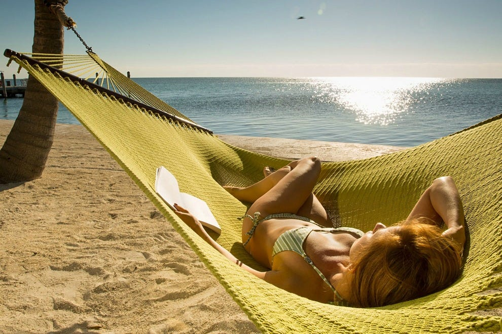 Relax the day away in a beachside hammock at Amara Cay Resort in Islamorada