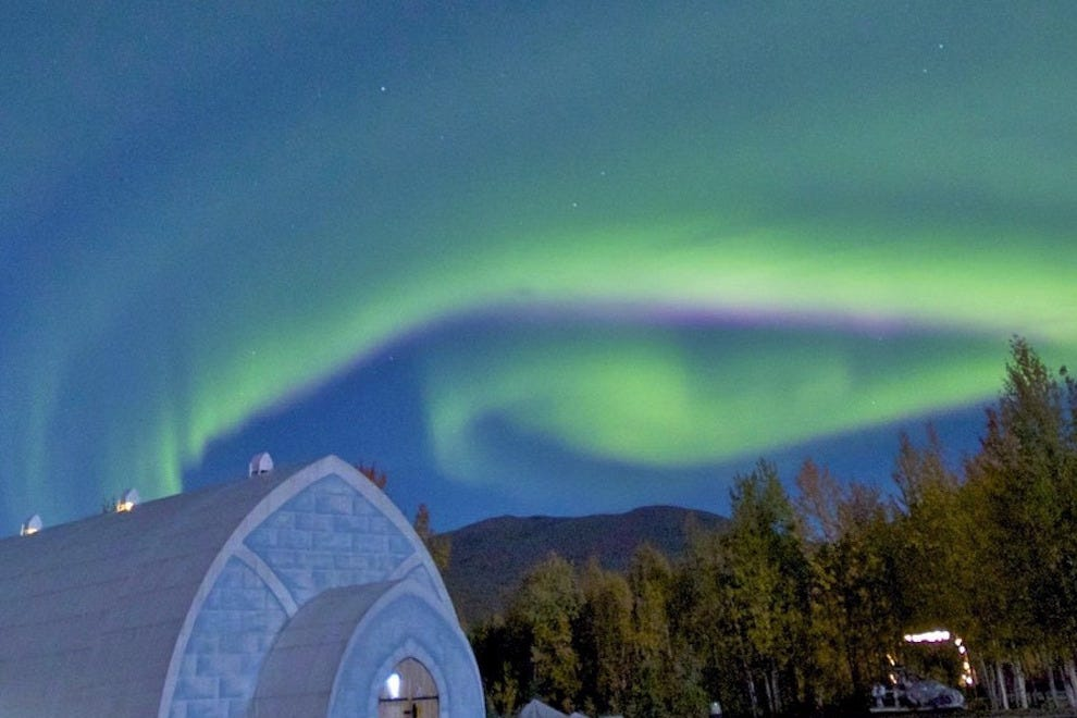 Aurora swirls over ice museum at Chena Hot Springs Resort, Fairbanks, Alaska