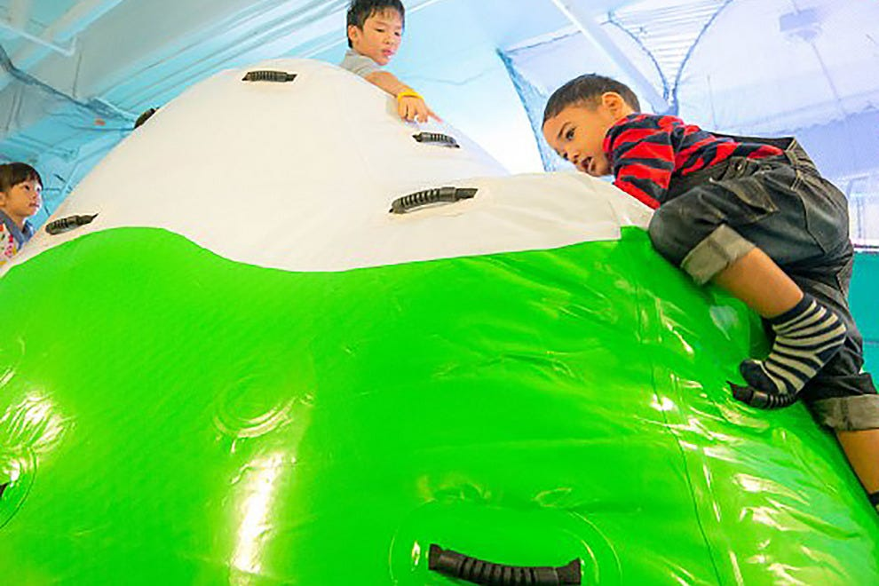 Kids climb Mount Meteori at Imaginia