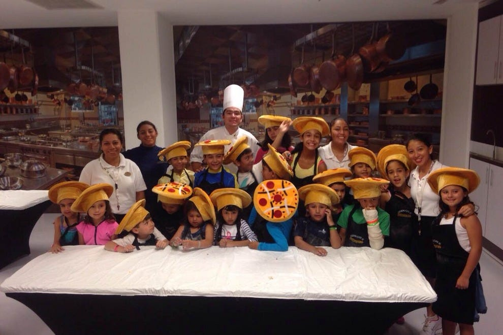 Kids prepare pizza and cookies in the Coral KidZ Club cooking classes