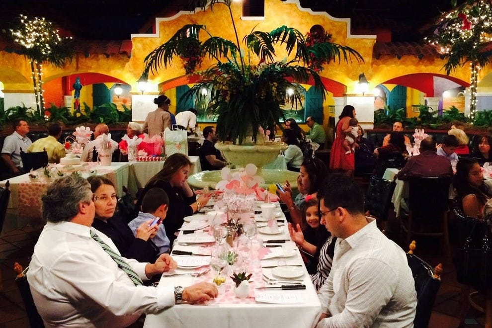 Patrons dine as though seated in an outdoor Spanish colonial courtyard