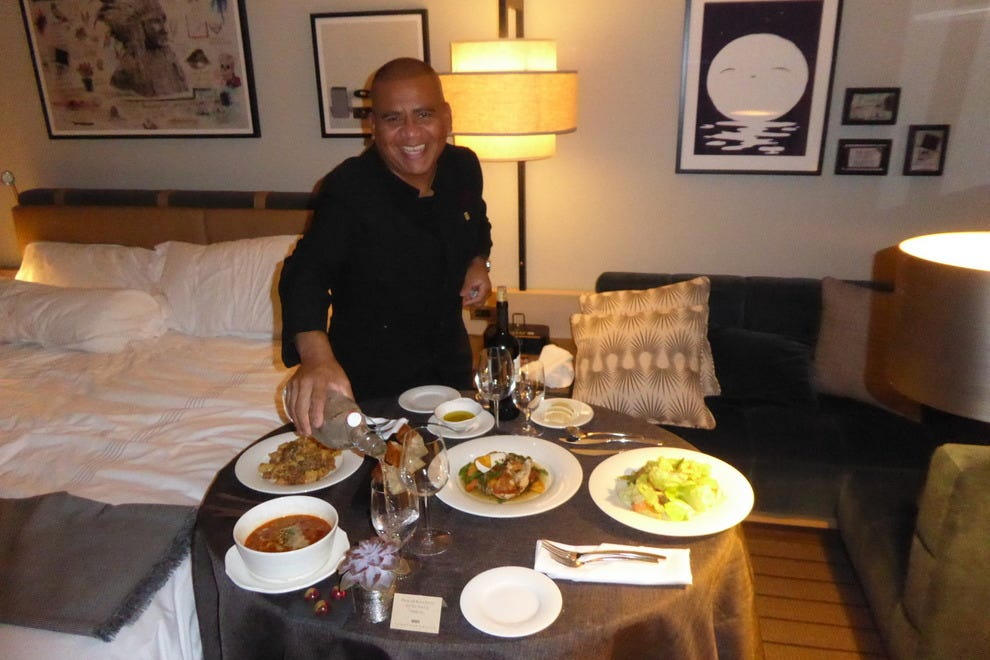 A server from Nico Osteria sets up dinner in a room at the Thompson Chicago hotel