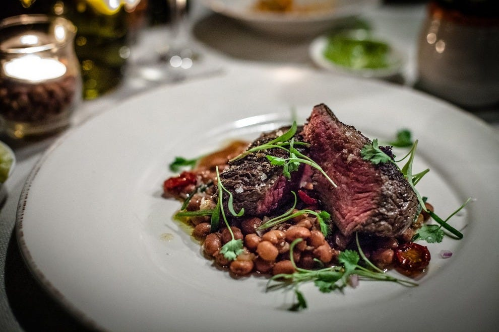 Twelve-hour tri-tip, beer-braised pinquito beans, cured tomatoes and micro cilantro at Barbareno