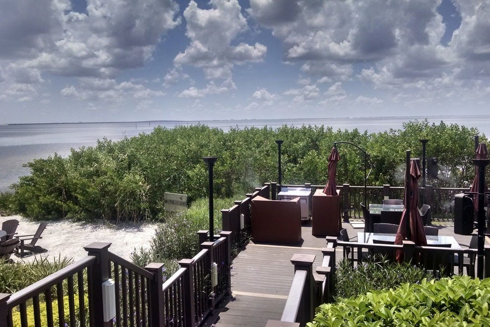Take a seat on the expansive patio at Oystercatchers to enjoy beautiful views of Tampa Bay
