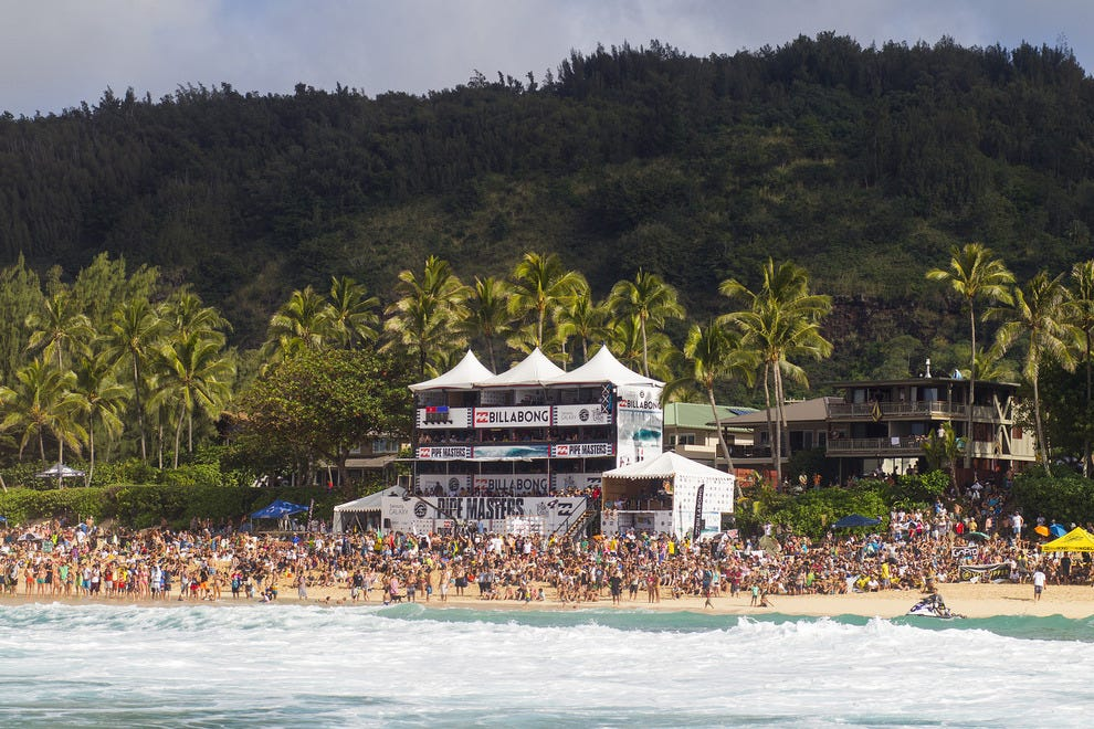 Crowds of people line the beach to watch the world's best surfers during last year's Billabong Pipe Masters