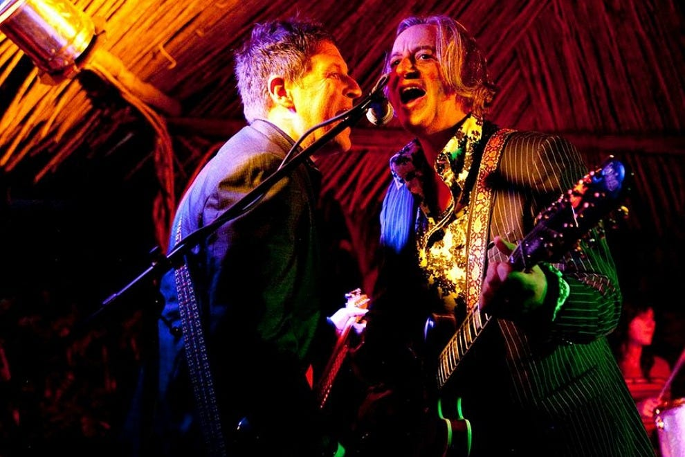 Former R.E.M. lead guitarist Peter Buck (right, with Steve Wynn) founded the Todos Santos Music Festival in 2012