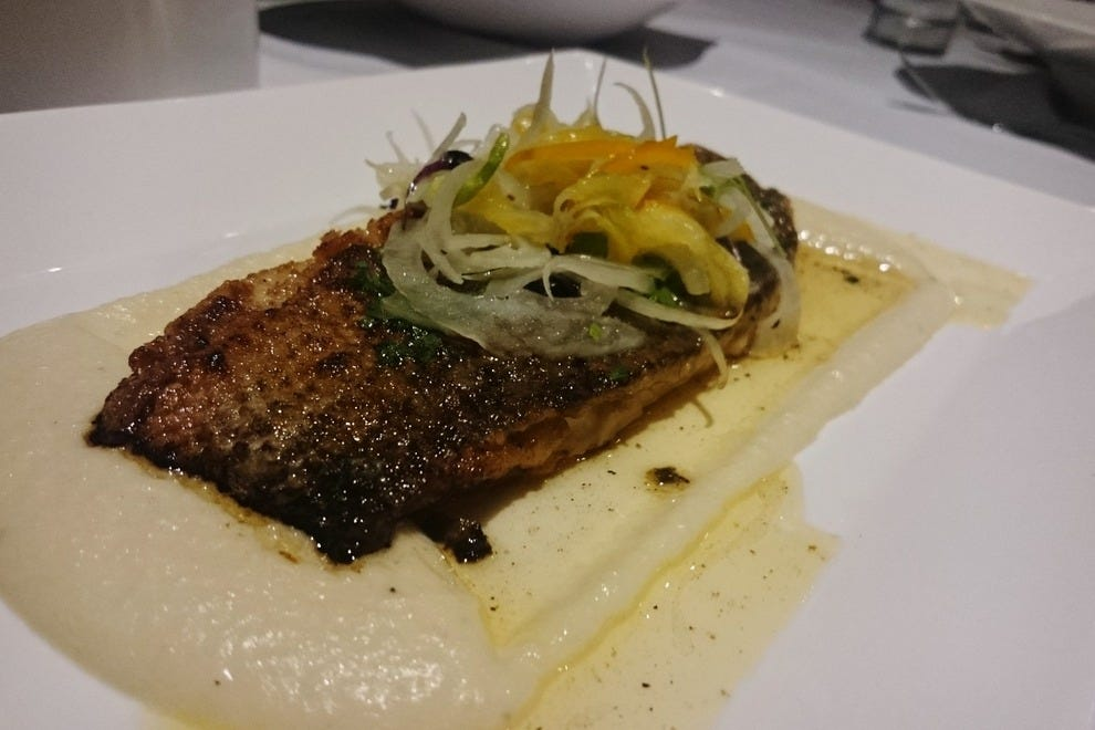 The Striped Bass Meuniere features brown butter, cauliflower potato purée, fennel and lemon confit