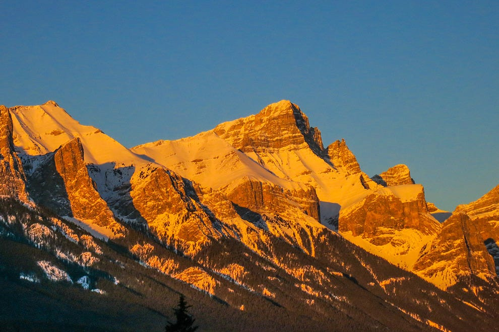 Alpenglow sunrise over mountains at Canmore AB