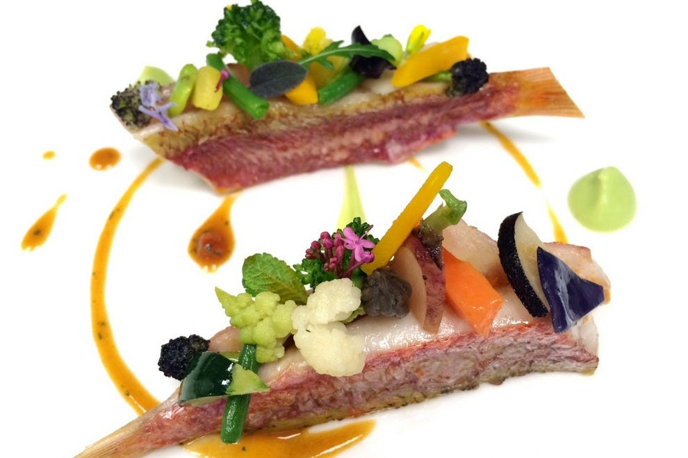 The menu for Flavors of Monaco features flair and fish