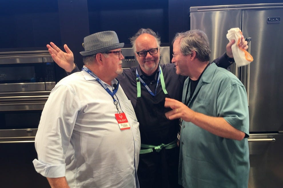 James Beard award-winning Chef Tony Mantuano (middle) shares a laugh with River Roast Executive Chef John Hogan (left) and radio personality, Lin Brehmer, at Chicago Gourmet