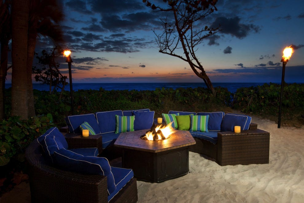 Cozy fire pit by the sea invites star-gazers.